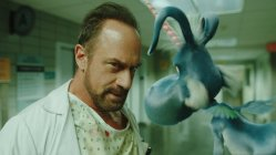 "HAPPY! -- ""Pilot"" Episode 101 -- Pictured: (l-r) Chris Meloni as Nick Sax, Patton Oswald as Happy! -- (Photo by: Syfy)"